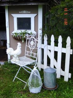Pretty wrought iron garden chair, painted rooster & a few pretties to decorate the chicken coop. LOVE that window box too!!