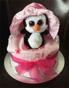 little pink penguin nappy cake is adorable.