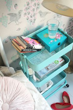 Multiple tiers means you can have everything you need handy. Try using pretty, decorative boxes to store unsightly things you need to access frequently (aka earplugs and mouthguard), and use the bottom to stash books and anything else. Source: The Freelancer's Fashion Blog