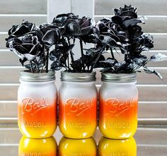 Halloween ball mason jars with black  frosted roses =LOVE