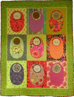 Baby Babushka baby quilt sewn in Kaffe Fassett fabrics.