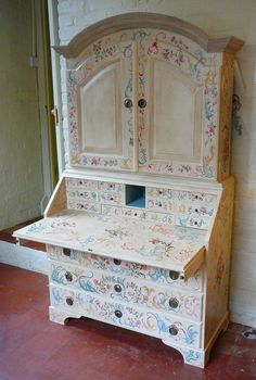 A commission undertaken by Lottie Ooi - a highly decorated secretaire painted in the style of an 18th Century Italian original. Every surface has been covered in carnations, roses and scrolls. The entire secretaire was painted free-hand in Annie Sloan Chalk Paints and aged with Annie's soft waxes.