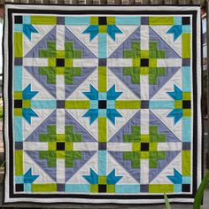 This Bright Geometric Baby Quilt uses beautiful shades of blues and greens to make an adorable baby quilt! Perfect for a little boy or girl, this baby quilt is easy to make and will look cute in any home.