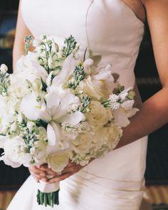 Classic white wedding bouquet: http://www.stylemepretty.com/little-black-book-blog/2014/09/19/classic-viriginia-golf-club-wedding/   Photography: Katie DeLorme - http://www.katiedelorme.com/