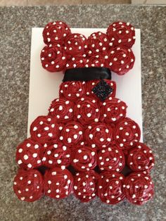 Pull apart cake to match my friend's red and white polka dot birthday dress. Inspired by a Pinterest post of a wedding dress pull-apart cake.