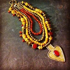 "ROX 'Soraya Tarzi' Necklace with Vintage Carnelian, Onyx, Tibetan Carnelian Discs, dyed Bone, Mali brass, Afghan Pendant and hammered brass clasp.  22""  $400"
