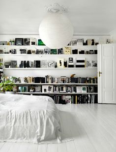 Wall-to-wall shelving in the bedroom.