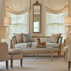 This style roman shades for living room.  note they are layered with conrads SOLIS BETANCOURT & SHERRILL