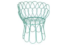 This aqua garden chair would look great nestled in the garden.
