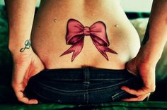 bow tattoo...<3 without the dermals