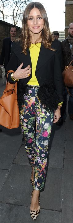 Olivia always looks classy even when wearing yellow and black, floral pants and leopard shoes. PS. Olivia, I see your tiny black belt with small metal accents.