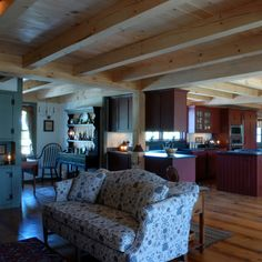 Keeping Room and Kitchen with Wide Pine Flooring And Timberframe Ceiling