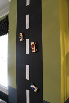 Magnetic painted road on the wall for metal cars....Reece
