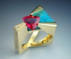 Ring   John Biagiotti. 18k gold,  2.49 carat trillion cut Pink Tourmaline, an underlay of Druse Chrysocolla, and .40 carats in channel set diamonds.