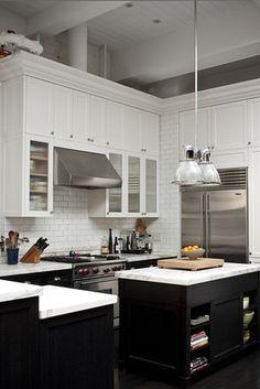 Open kitchen, white cabinets with dark floors