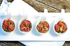 "Hawaiian Ahi Poke. (Pronounced ""POH-keh""). This fresh seafood salad (that comes in a variety of flavorful recipes) is very popular all over the Islands. As an appetizer, poke makes a splash at any holiday party served in shot glasses, or even in Chinese soup spoons (as pictured)! DELISH!!"