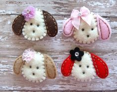 Handmade felt Puppies with flowers or bows.
