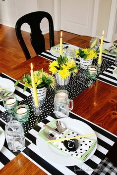 Summer Table Decorating Ideas - a bright and welcoming tablescapes with black and white and yellow accents.