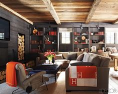 Warm & cozy. Love the contrast of dark walls w/ natural wood ceiling.