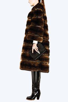 Coat, Ralph Rucci for Pologeorgis Furs. Saks Fifth Avenue; 877-551-7257. Sweater, $1,495, Donna Karan New York. 866-240-4700. Watch, $4,600, Chanel Watch. Clutch, $870, Proenza Schouler. Proenza Schouler. Boots, $995, Theyskens' Theory.