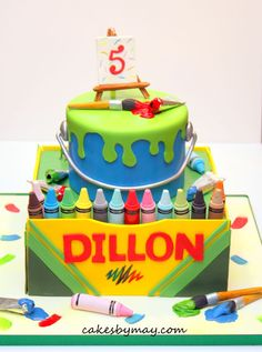 I was given total creative freedom on this fun arts and crafts birthday party cake.  Love how it turned out!  So fun with all the bright colors.  Crayons and other details made of fondant.