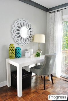 Living room walls: Moonshine by Benjamin Moore color matched to Olympic No-VOC paint in satin. Trim: Olympic No-VOC off-the-shelf white paint in semi-gloss. Beams: Shaker Gray 1594 by Benjamin Moore, color matched to Olympic No-VOC paint in satin (dry-brushed on, see this post).