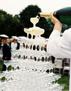 A champagne waterfall, how do we not see this at every wedding?!