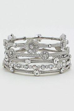 Embellished silver bracelets that you can stack.