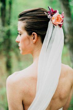 wedding veil with flower accessory, photo by Lev Kuperman http://ruffledblog.com/kaaterskill-ny-wedding #weddingaccessories #brides