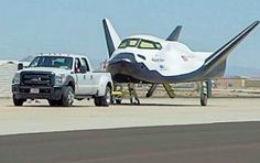 The Dream Chaser Engineering Test Article being towed during taxi maneuvering tests (Photo...