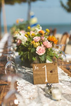 painted wood table numbers   Photography by cptphotography.com, Florals by http://www.jmorganflowers.com  Read more - http://www.stylemepretty.com/2013/08/28/islamorada-wedding-from-concept-photography-2/