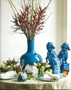 Blue turquoise foo dogs, table setting, tablescape, blue and green and white
