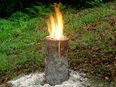 "Swedish Log Candle - burning  Nifty idea, cut wedges in top of log about  half way, poor a ""fuel"" ie: gas, diesel, kerosene, and let it soak a few minutes, stand back before lighting it. be careful. click thru to website for details."