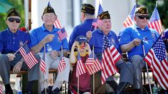 Veterans from VFW Post 8469 ride on a float at a parade in Fairfax.
