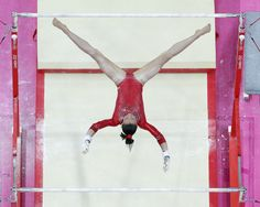 U.S. gymnast Kyla Ross performs on the uneven bars during the Artistic Gymnastic women's team final at the 2012 Summer Olympics, Tuesday, July 31, 2012, in London. (AP Photo/Julie Jacobson)