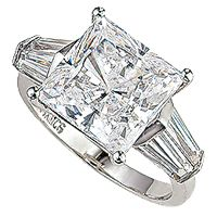 Classic style solitaire engagement ring featuring a princess cut cubic zirconia center stone with two tapered baguettes on each side. Available in 14K white gold or 14K yellow gold. Model 2128Q