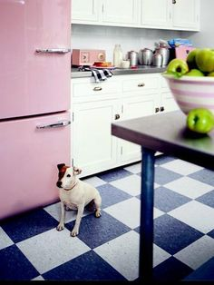 This cutie waits expectantly by the fridge, a brand-new one made to look retro and custom painted.