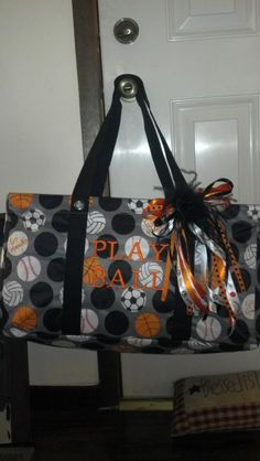 """A large utility tote in pap dot from Thirty-One creatively decorated with a sports theme! (These balls were """"colored"""" on there, the pattern comes with plain white dots.)"""
