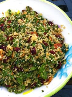 Quinoa and Kale Winter Salad with cranberries, raisins, walnuts, and parmesan. #healthyholidays #wintermeals