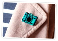 Boring Blazer? Tiresome Trench? Stupid Suit?  No need to rush out for a full-on makeover. Give your stale clothes a splash of character with a DIY Camera Brooch.  All it takes are a few supplies and your kindergarden coloring skills.  You're just twenty minutes away from adding fashionable flair to your wearisome wardrobe.