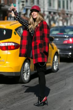 She could totally stop traffic with that buffalo plaid.  Street Style New York Fashion Week 2014 #NYFW