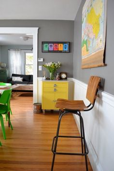 love the grey walls and the yellow bureau, not to mention the green chair