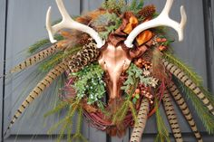 "Wildlife antler wreath "" Copper Mule Deer "". $150.00, via Etsy."