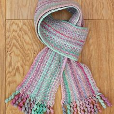 Follow a few simple steps to work out your own pattern for this Bouclé Stitch scarf with twirly curly tassels.