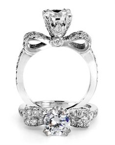 Reminiscent of sheer femininity, this Knot engagement ring designed by TRUE KNOTS® for The Knot Collection is sensual and inspired by the warmth of an embrace. Sparkling with 0.45tcw of diamonds, this engagement ring is sure to win her heart. Ring can accommodate any size round center (center not included). Available in platinum and gold.