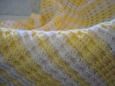 Yellow and white baby afghan; waffle stitch.