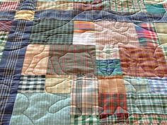 Plaid quilt - I love the moose and bear quilting pattern on it!