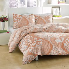 City Scene Medley Coral bedding offers fashionable style at affordable pricing. Medley Lagoon is a two-tone ogee print in coral and ivory. A large ogee design encompasses the entire comforter/duvet face. The comforter and duvet reverse to a mini ogee print. Anyone looking to redo the look of their bedroom should consider Medley or another graphic print from City Scene. Starting at $59.99 #beddingstyle #cityscene #beddingset #bedding #comforter #comforterset #homedecor