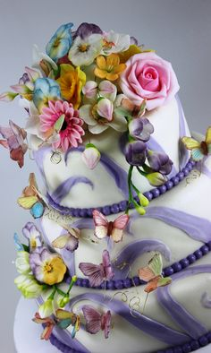 wedding cake, flowers and butterfly