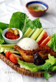 Ayam goreng dan lalapan -- Indonesian fried chicken, raw vegs, and sambal oelek